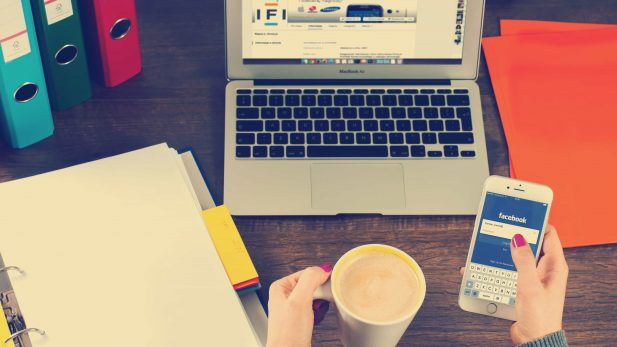 woman with coffee use facebook as social media marketing tool